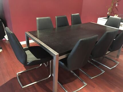 Dining table with eight chairs