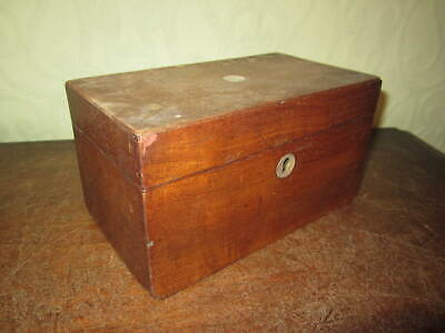 An antique C19th mahogany tea caddy with mother of pearl escutcheon