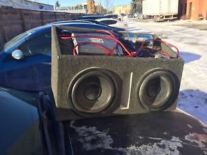 Used subwoofer, with box, 700amp. And capacitor.