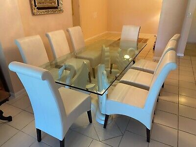 Mint glass dining room table set with seating for 8