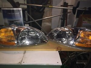 Pair of Honda civic headlights for sale,$100 OBO.