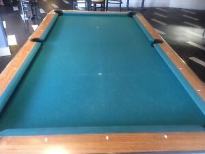 Pool table (complete with cues and balls)