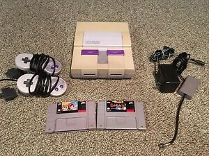 Super Nintendo w/2 controllers and 2games