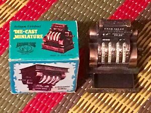 Die cast miniature National cash register pencil sharpener