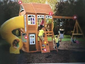 Wooden play set swings, play house and slide