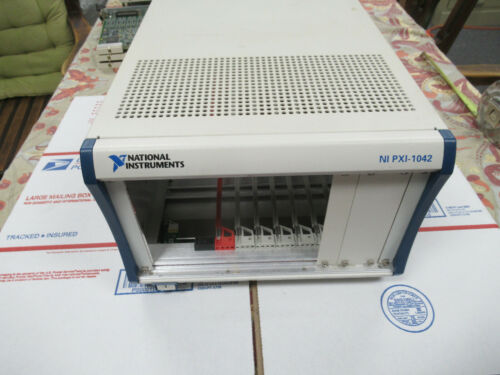 NATIONAL INSTRUMENTS NI PXI-1042 CHASSIS MODULE AS PICTURED &TC-4