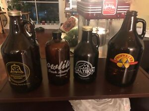 Assorted 2L and 1L glass growlers