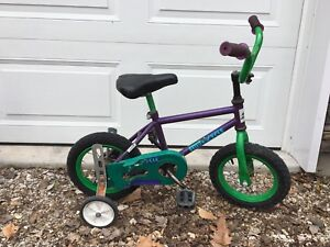 Toddler bike with training wheels -green and purple