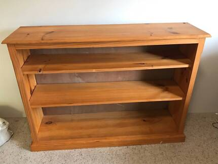 Low-level wooden bookcase