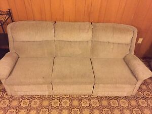 Couch and matching reclining chair, delivery available