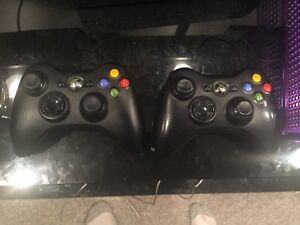 Xbox 360 w 2 controllers and 21 games great condition 150$ obo