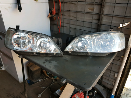 Ford falcon BA headlights left and right perfect condition