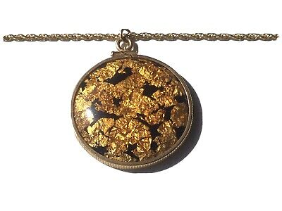 1950s Jewelry Styles and History Authentic Vintage 1950's Gold Flake Lucite Pendant/Necklace $19.00 AT vintagedancer.com