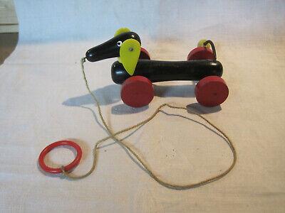 - Vintage Brio wooden Dachshund dog pull toy