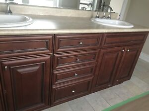 Bathroom sinks, faucets, light fixtures and drawers with mirrors