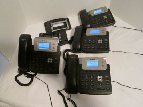 Yealink T21E2 IP phone set of 4 W/adapters and three base stands