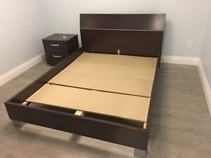 Wooden brown bed with nightstand