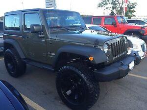 2015 Jeep Wrangler Sport.  $33,000 obo