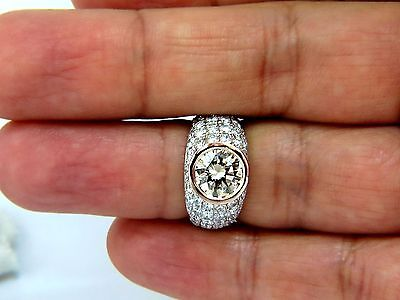 GIA Certified 3.08ct. Fancy light brown round cut diamond ring 14kt + 8