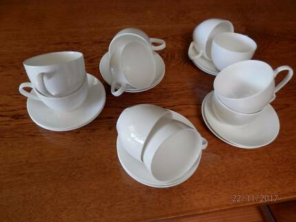 Ten  unused cups and saucers