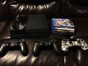 PS4 w/ 3 Controllers and 4 Games