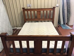 Solid wood queen bed and with & mattress delivery available