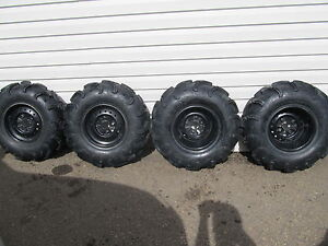 SET OF 4 MAXXIS ZILLA 6 PLY TIRES MOUNTED ON 4 BOLT /110 RIMS.