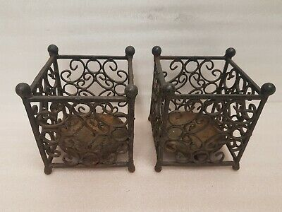 A PAIR OF WROUGHT IRON CANDLE HOLDERS