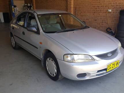 FORD LASER HATCH