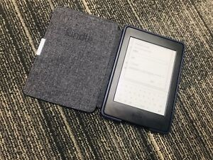 Kindle Paperwhite Almost New condition still has Warranty on it!