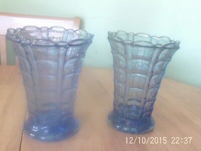 pair of matching blue glass vases
