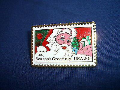 "Santa Stamp, 1983, pin/button, 1 1/2"" x 1"""