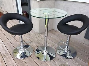 Glass bar table and stools.