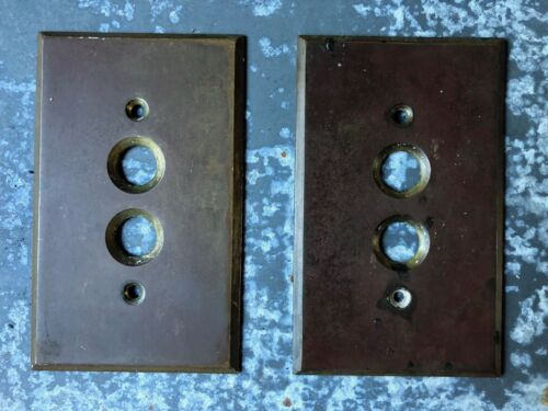 Pair of Vintage stamped brass push button switch plates
