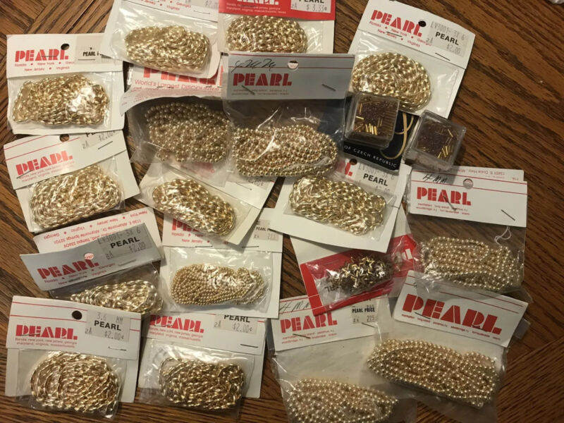 19 bags of assorted gold beads on a string