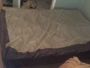 Free queen size air mattress, pump included.