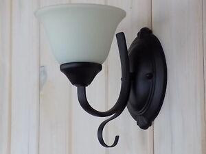 Two black metal wall sconces