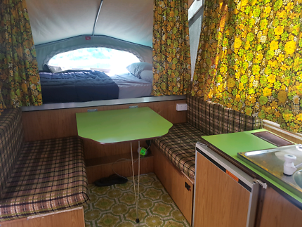 Jayco dove camper van with awning and side fly over beds