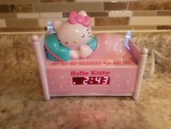 HELLO KITTY Alarm Clock Sleeping Kitty AM/FM Radio Night Light Plug In Battery