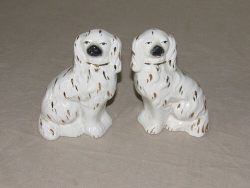 SUPERB PAIR STAFFORDSHIRE SEATED WHITE & GILT SPANIEL DOGS