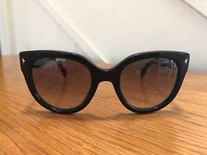 4506e1811f Prada Cat Eye Swing Sunglasses