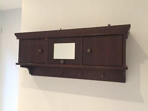 Wall cabinet with hooks