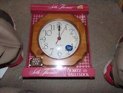 Seth Thomas Quartz Clock NEW 10 inch by 10 inch. Wood Frame