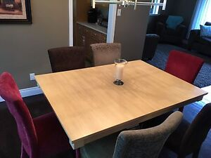 Solid oak dining room table & chairs for sale