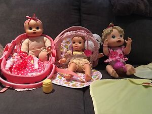 Assorted baby dolls and accessories