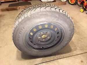 SET OF 4 SNOW TIRES ON RIMS 215/65R 16