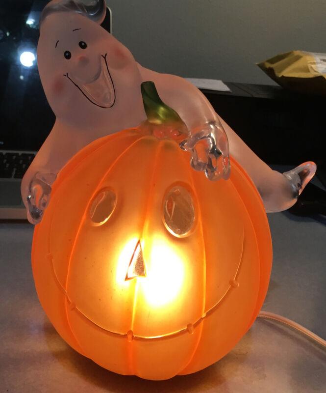 Ghost On Pumpkin Light. Halloween. Jack-o-Lantern.