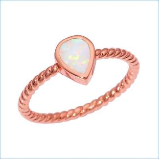 WHITE FIRE CREATED OPAL STERLING SILVER & ROSE GOLD FILL RING.
