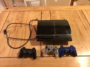 PS3 plus 3 wireless controllers