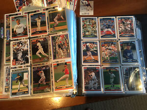 80 page album of hockey and baseball cards
